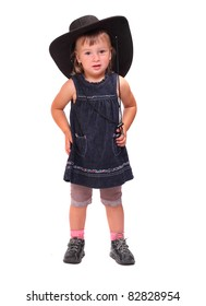 Little girl with big hat on a white background.