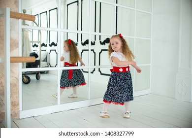 little girl at the big mirror
