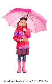 Little girl with big pink umbrela