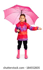 Little girl with big pink umbrella checking if it's still raining