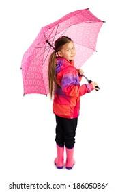 Little girl with big pink umbrella