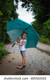 little girl with  big umbrella outdoor