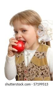 The little girl biting an apple