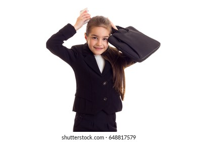 Little girl in black jacket holding diploma and smartphone
