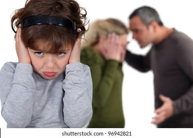 Little girl blocking out her parents' argument
