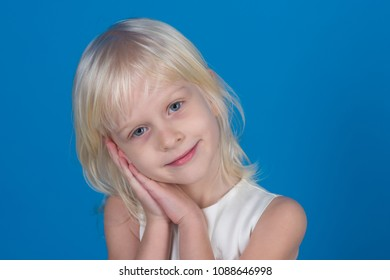 Little girl with blond hair hold hands at face