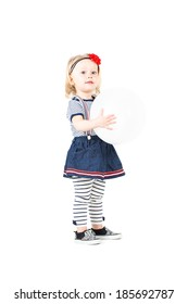 little girl in blue denim skirt with white baloon