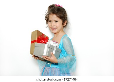 The little girl with a blue dress with gifts on a light background