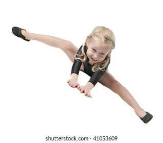 little girl in bodysuit for rhythmic gymnastics trying to do the splits isolated on white