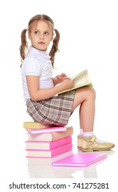 Little girl with book. The concept of education in school or kindergarten. Isolated over white background