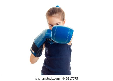 little girl in boxing gloves practicing by punch