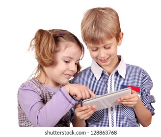 little girl and boy fun with tablet pc on white