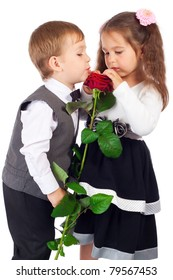 Little girl with boy and red rose