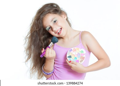little girl with a brush for makeup isolated on white