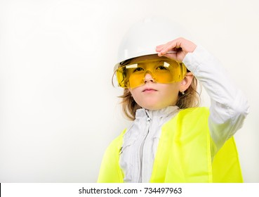 little girl Builder in a white helmet and vest