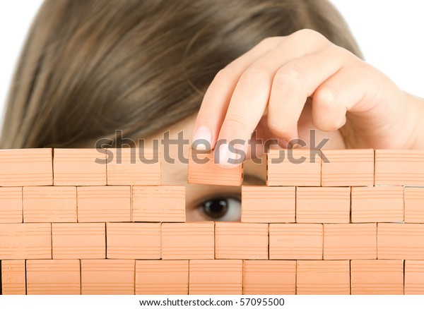 little girl building a wall