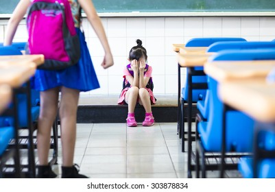 little girl bullying in school classroom