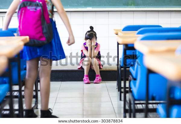 little girl bullying in school classroom