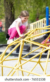 little girl in busy park