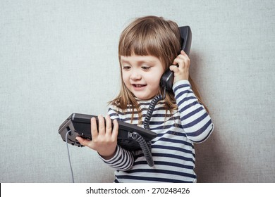 Little girl calling phone