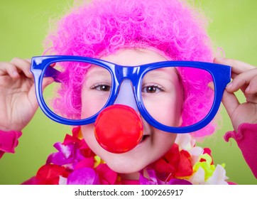 little girl with carnival mask as a clown