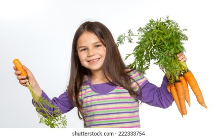 Little girl with carrots.