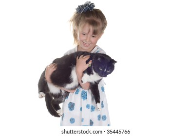 Little girl with cat in studio