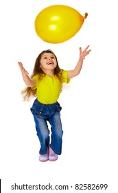 A little girl chasing balloon isolated on white background