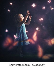 A little girl chasing glowing butterflies at night
