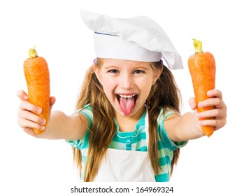 little girl in chef hat with two carrots shows tongue on a white background
