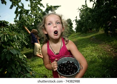Little Girl with a Cherry in her Mouth