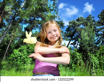 little girl with a chicken