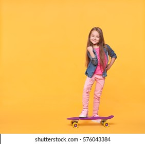 little girl child in colorful clothes showing success gesture