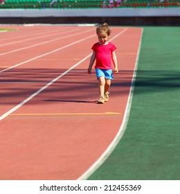 little girl child involved in athletics at the stadium