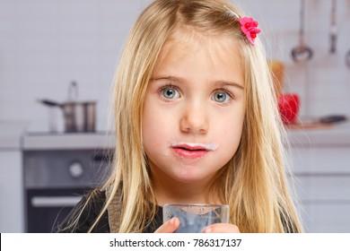 Little girl child milk moustache kid glass healthy eating kitchen