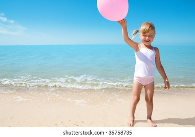 little girl child on coast of sea