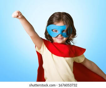The little girl child in a superhero costume