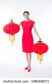 """little girl in chinese traditional dress with lantern with many """"luck"""" on it."""