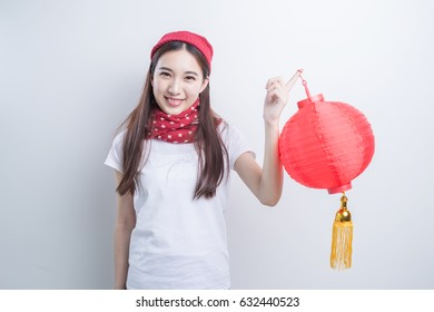 little girl in chinese traditional dress with lantern