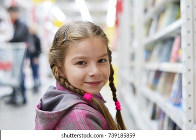 little girl chooses books