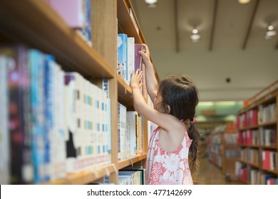 Little girl choosing a book