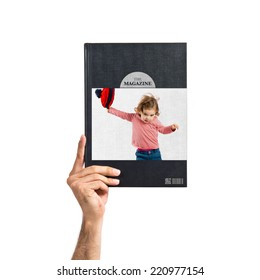 Little girl with Christmas hat printed on book