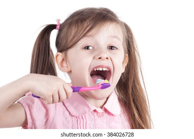 little girl cleaning teeth with tooth brush. Isolated white background.