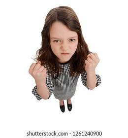 Little girl clenched her fists. Bad mood and agressive behavior. Anger and bullying concept.