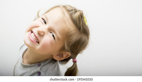Little girl clenching her teeth