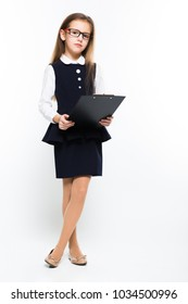 Little girl with clipboard in her hands dressed as a businesswoman