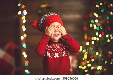 little girl closed eyes  her hands in anticipation of a Christmas miracle and a gift