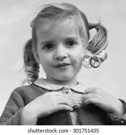 Little girl closeup outdoors