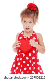Little girl clutched to her chest heart.Studio photo, isolated on white background.