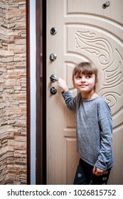 A little girl comes out of the apartment and opens a beautiful door
